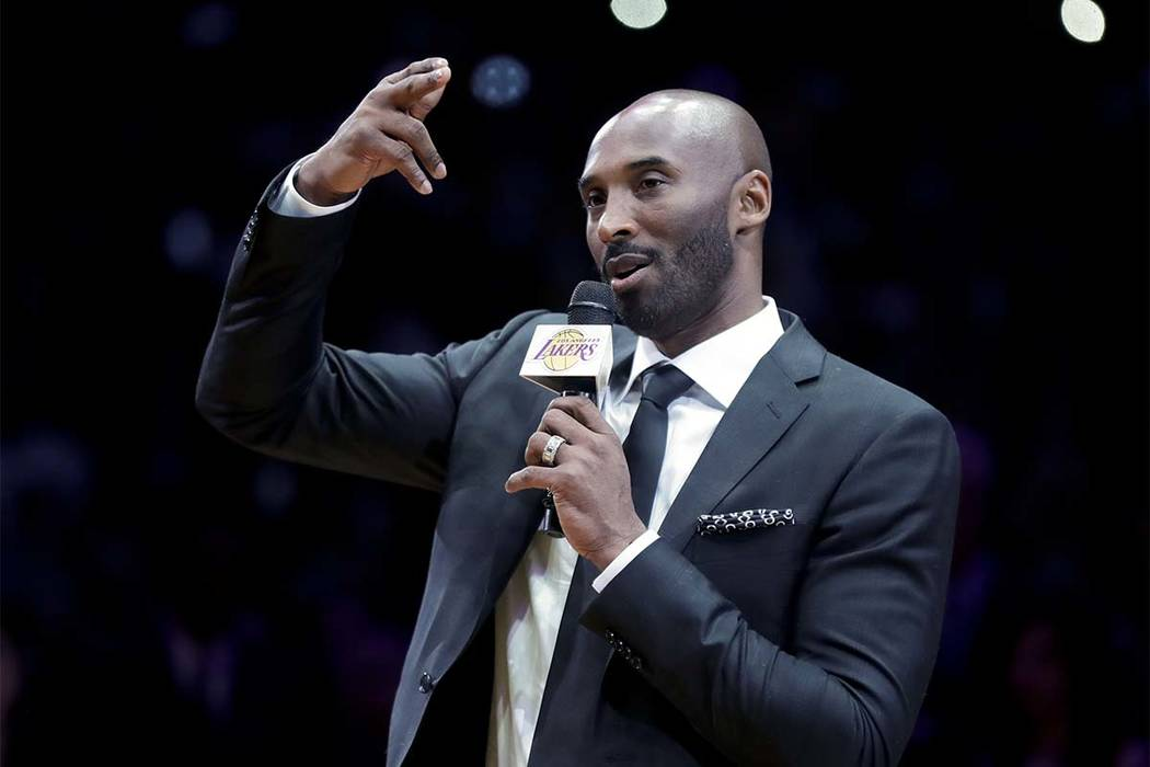 Former Los Angeles Laker Kobe Bryant speaks during a halftime ceremony retiring both of his jersey's during an NBA basketball game between the Los Angeles Lakers and the Golden State Warriors, in  ...