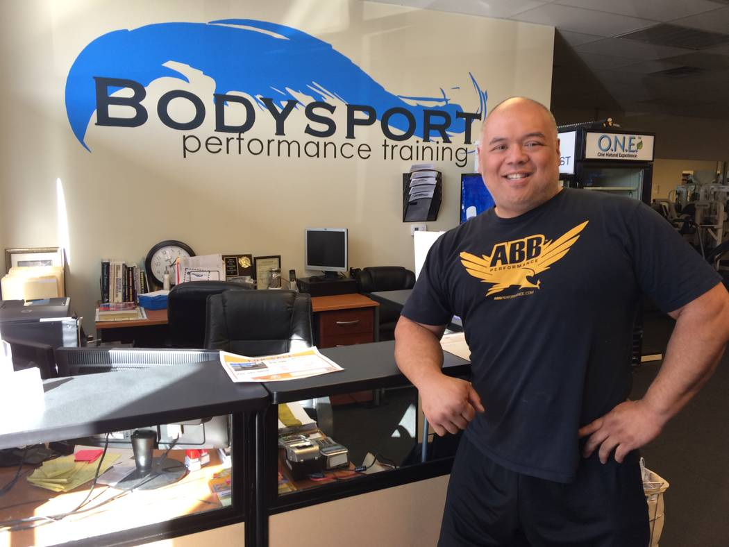 "Mel Fabros, certified trainer and owner/operator of Bodysport, relaxes near the front desk of his business, Bodysport. He has trained a number of men to lose more than 100 pounds. ""Americans, ou ..."