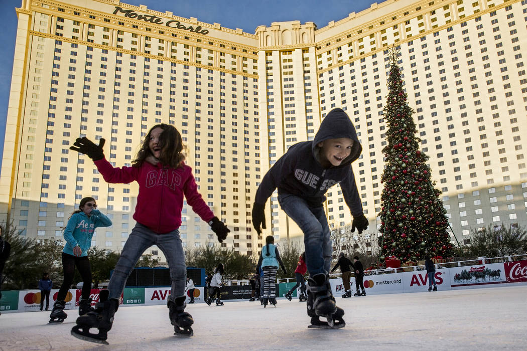 Ice skaters take advantage of a sunny day to enjoy the rink at Holiday at the Park outside T-Mobile Arena on Tuesday, Dec. 20, 2016, in Las Vegas. Benjamin Hager/Las Vegas Review-Journal