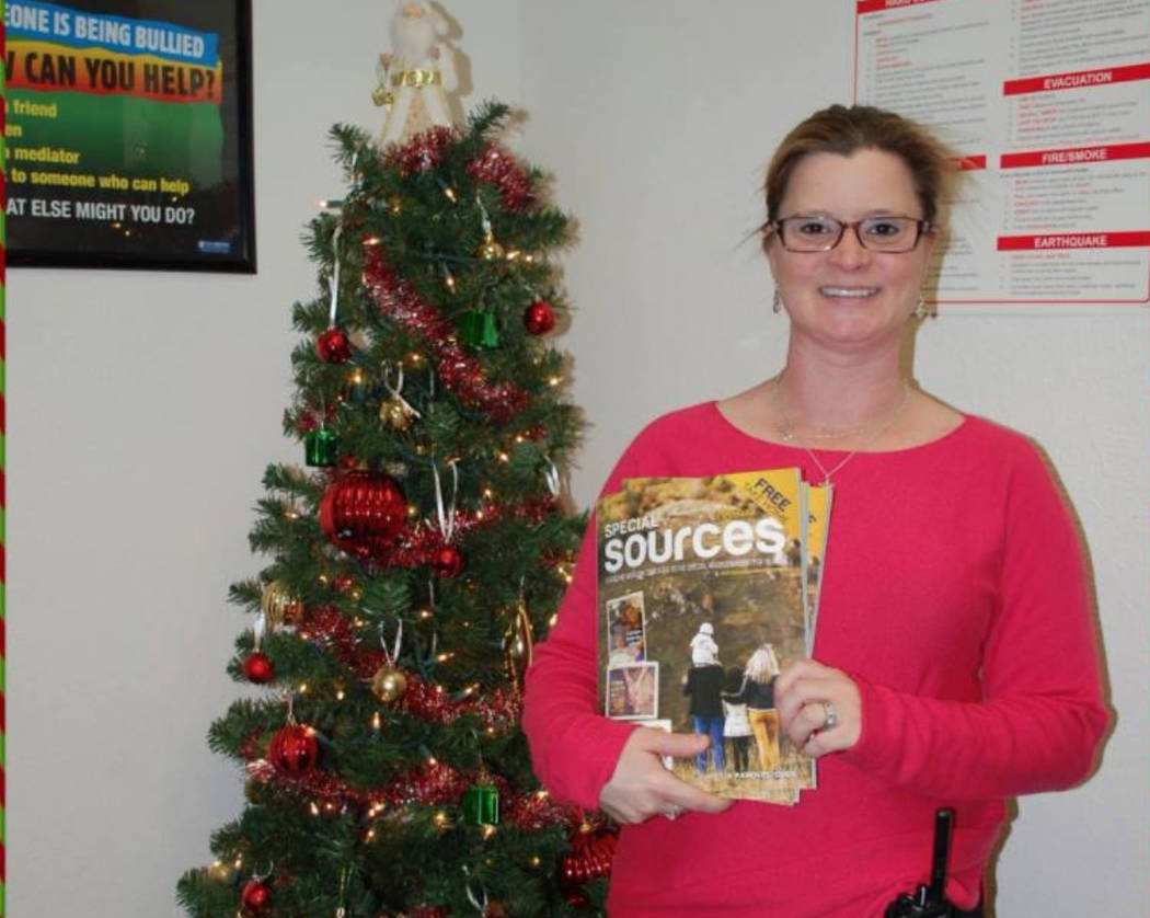 Tracy Pacheco, dean of students at Von Tobel Middle School, holds a copy of the first issue of the magazine Dec. 12, 2017. (Special Sources/SPECIAL)