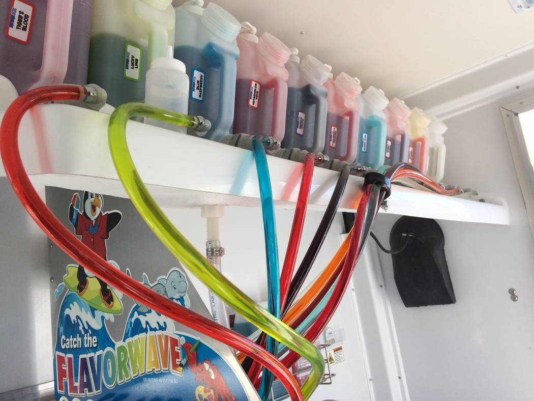 The tubing that bring flavors to the dispenser are seen Dec. 11, 2017 inside Steve and Sandy Smith's Kona Ice Truck. He is a former police officer with Metro and she had a desk job there. (Jan Hog ...