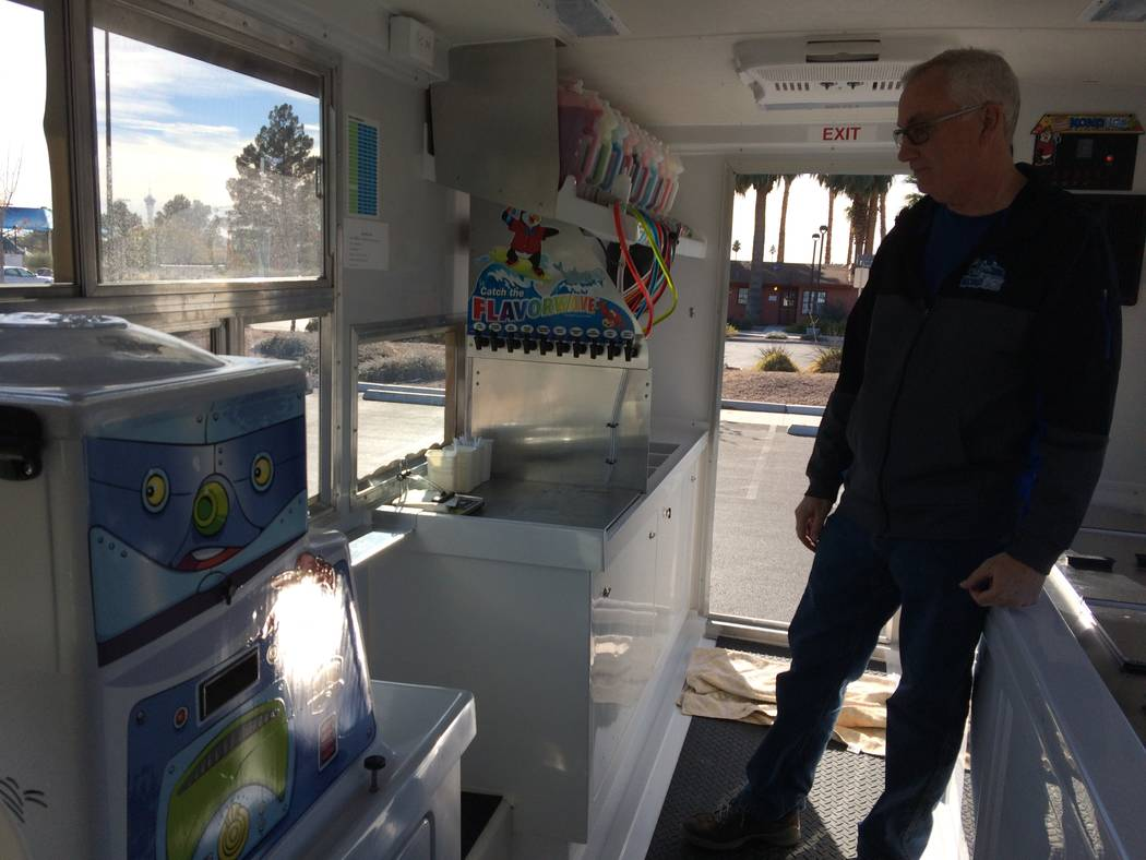 Larry Smith pauses Dec. 11, 2017, as he talks about is new business, a Kona Ice truck. The former Metro detective noted that his franchise area is where he used to patrol. The business model gives ...