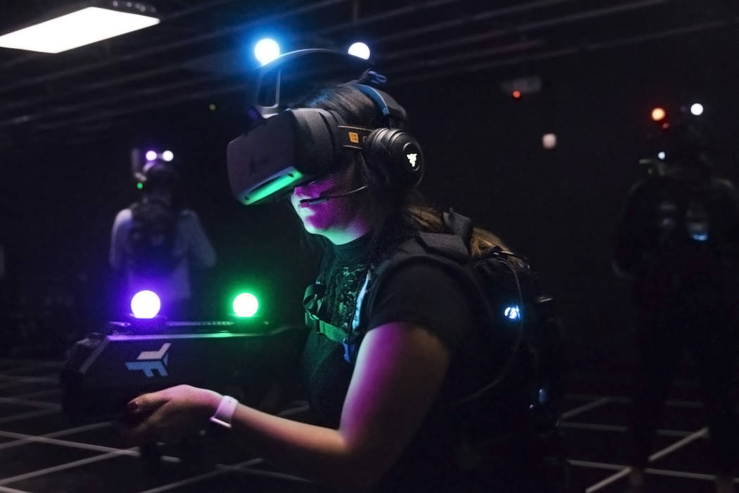 Joslyn Garcia, middle, hunts for targets while playing at a VR experience on Tuesday, September 5, 2017, at the MGM Grand hotel-casino, in Las Vegas. Benjamin Hager Las Vegas Review-Journal @benja ...