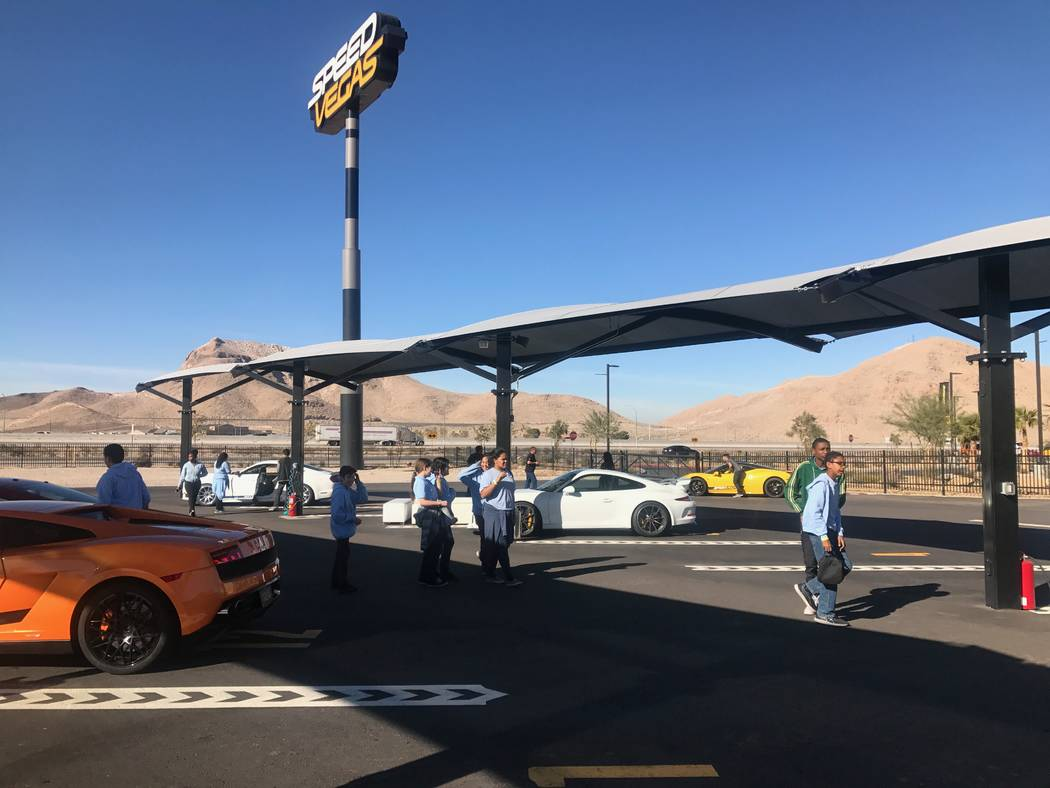The Delta Academy middle school students viewing exotic cars on Dec. 15, 2017 at SpeedVegas, 14200 S. Las Vegas Blvd. (Kailyn Brown/View) @KailynHype