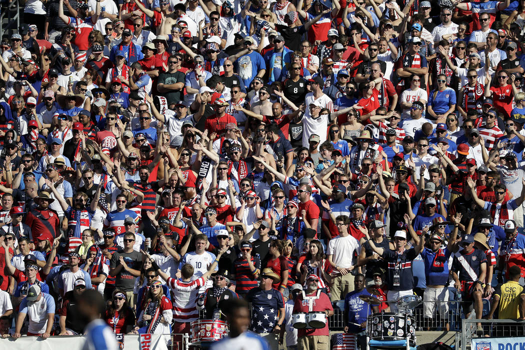 In this July 8, 2017, file photo, fans cheer during a CONCACAF Gold Cup soccer match between Panama and the United States, in Nashville, Tenn. A person with direct knowledge tells The Associated P ...