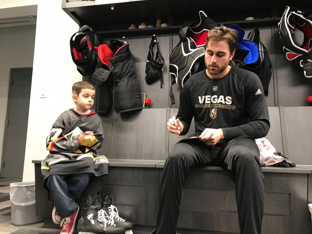 Gavin Prince gets an autograph from right wing Alex Tuch of the Vegas Golden Knights, Tuesday, Dec. 19, 2017. Make-A-Wish of Southern Nevada helped Gavin, 8, spend the day with the Vegas Golden Kn ...