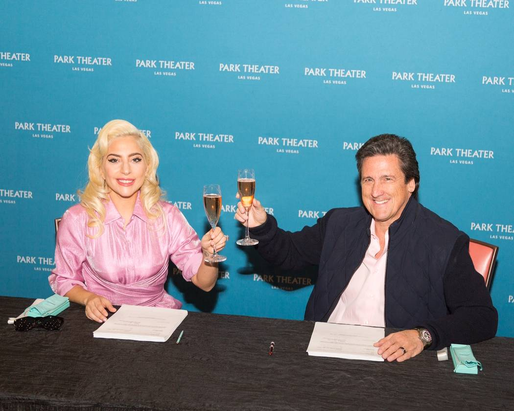 Lady Gaga is shown with MGM Resorts International President Bill Hornbuckle after signing her two-year, multishow contract to perform at The Park Theater on Wednesday, Dec. 19, 2017. (Alex Dolan)
