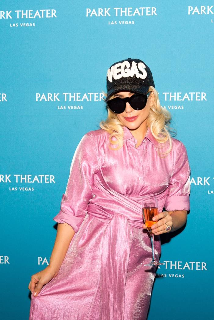 Wearing befitting headgear, Lady Gaga is shown after signing her two-year, multishow contract to perform at The Park Theater on Wednesday, Dec. 19, 2017. (Alex Dolan)