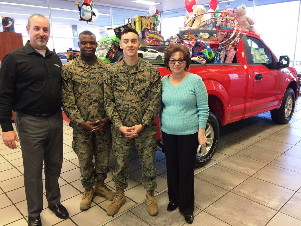 Friendly Ford Friendly Ford recently participated in the annual Toys for Tots campaign. Seen a 2018 F-150 packed with toys are, from left, dealership general sales manager Steve Crevling; U.S. Mar ...