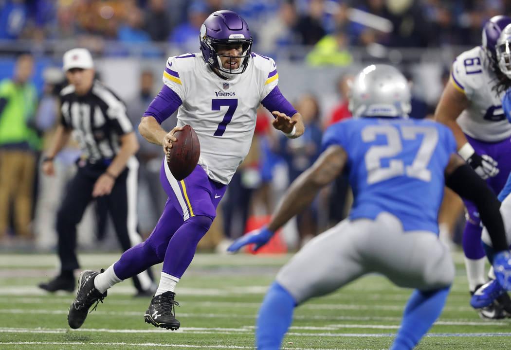 Minnesota Vikings quarterback Case Keenum (7) scrambles during the first half of an NFL football game against the Detroit Lions, Thursday, Nov. 23, 2017, in Detroit. (Paul Sancya/AP)