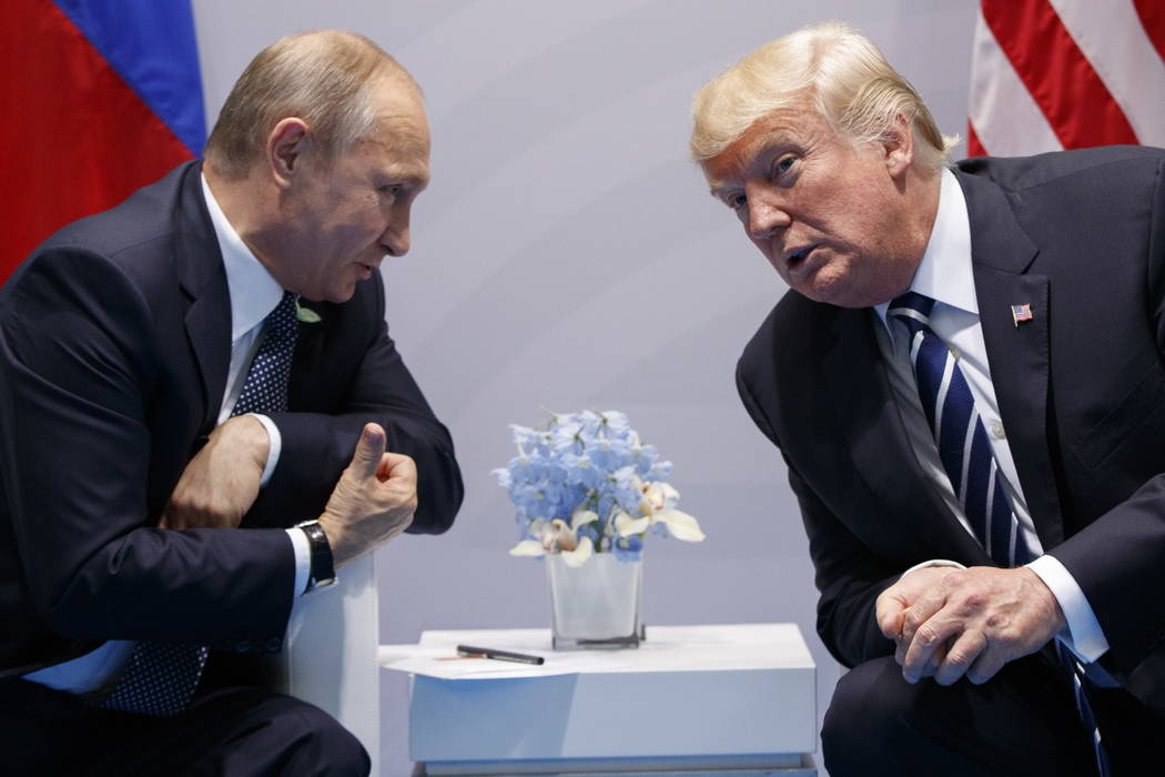 FILE - In this Friday, July 7, 2017, file photo U.S. President Donald Trump meets with Russian President Vladimir Putin at the G-20 Summit in Hamburg. After 18 years as Russia's leader _ an ...