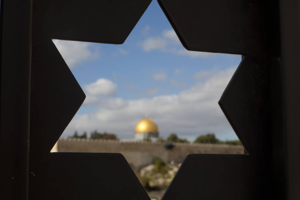 The Dome of the Rock Mosque in the Al Aqsa Mosque compound in Jerusalem's Old City is seen trough a door with the shape of star of David, Thursday, Dec. 7, 2017, a day after U.S. President Donald  ...