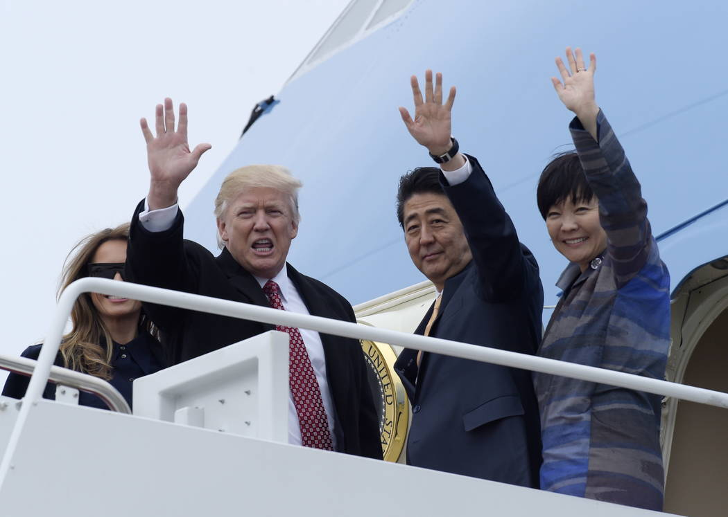 FILE - This Feb. 10, 2017, file photo shows President Donald Trump and Japanese Prime Minister Shinzo Abe, accompanied by their wives, first lady Melania Trump and Akie Abe, as they wave before bo ...