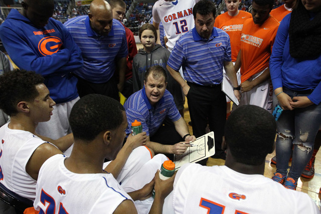 Bishop Gorman Head Coach Grant Rice talks to his team during the Division I championship game against Canyon Springs in the NIAA basketball state tournament at Lawlor Events Center, in Reno, Nev., ...