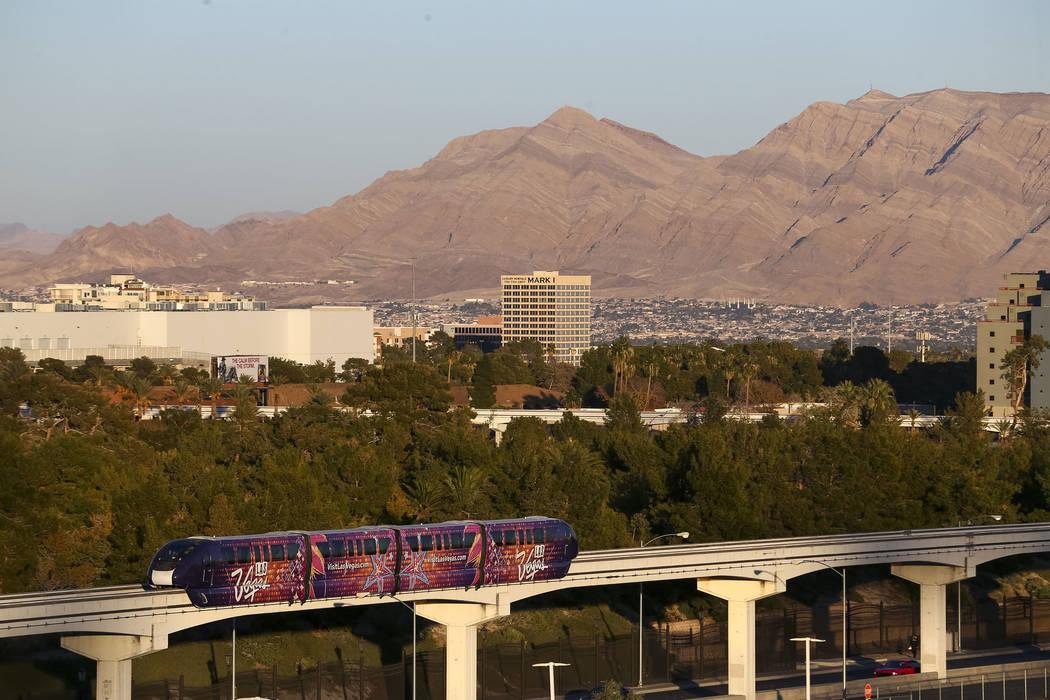 The Las Vegas Monorail moves above Sand Avenue on Thursday, Dec. 14, 2017. Richard Brian Las Vegas Review-Journal @vegasphotograph