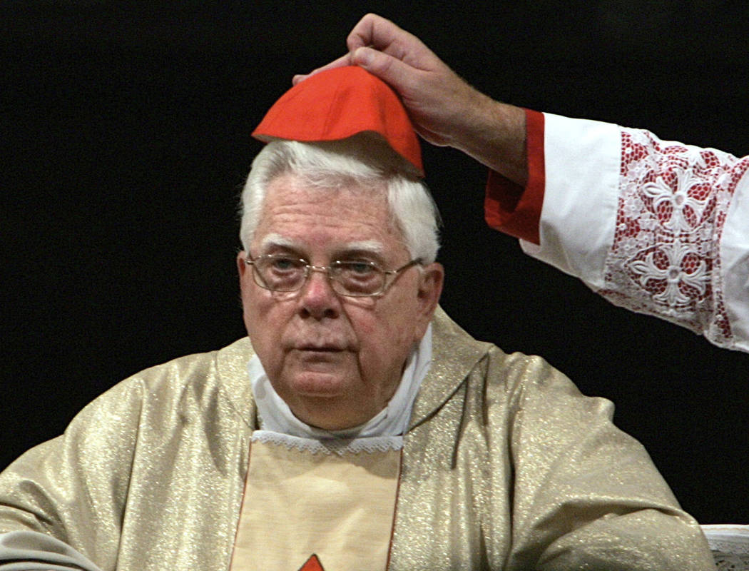 FILE - In this Thursday, Aug. 5, 2004 file photo, Cardinal Bernard Law has his skull cap adjusted during the ceremony for Our Lady of the Snows, in St. Mary Major's Basilica in Rome, Italy. An off ...
