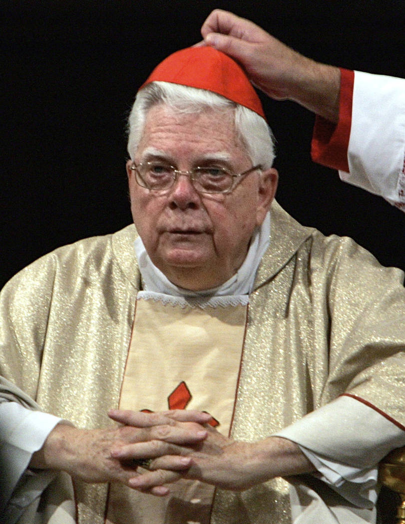 In this Thursday, Aug. 5, 2004 file photo, Cardinal Bernard Law has his skull cap adjusted during the ceremony for Our Lady of the Snows, in St. Mary Major's Basilica in Rome, Italy. An official w ...