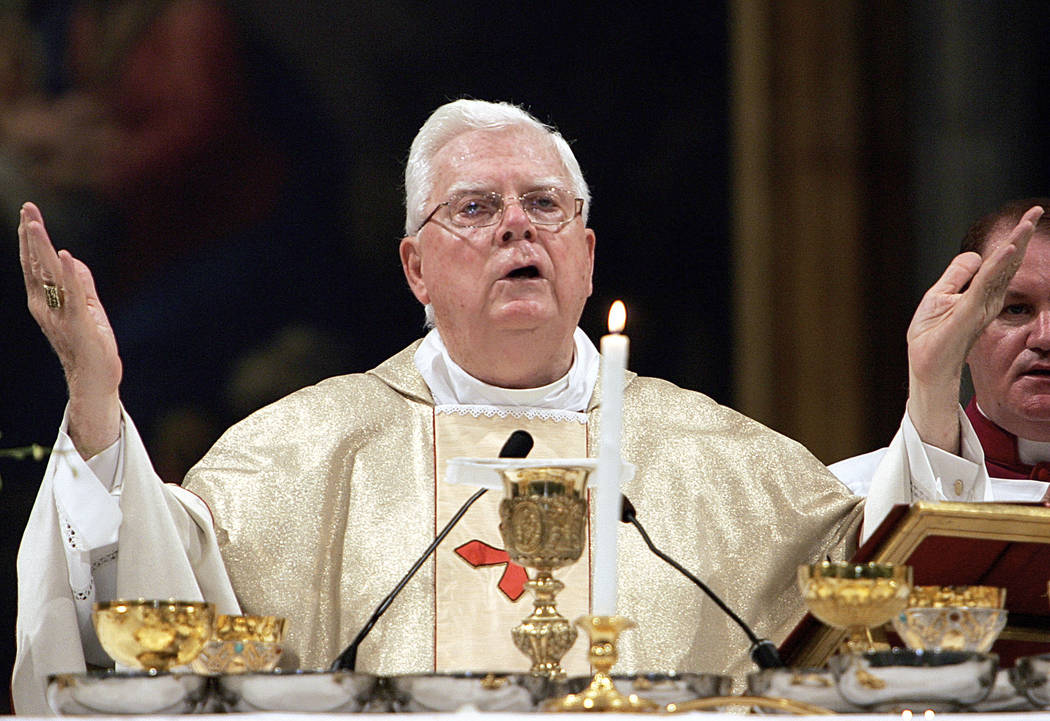 In this Thursday, Aug. 5, 2004 file photo, Cardinal Bernard Law celebrates Mass during the ceremony for Our Lady of the Snows, in St. Mary Major's Basilica, in Rome, Italy. An official with the Ca ...