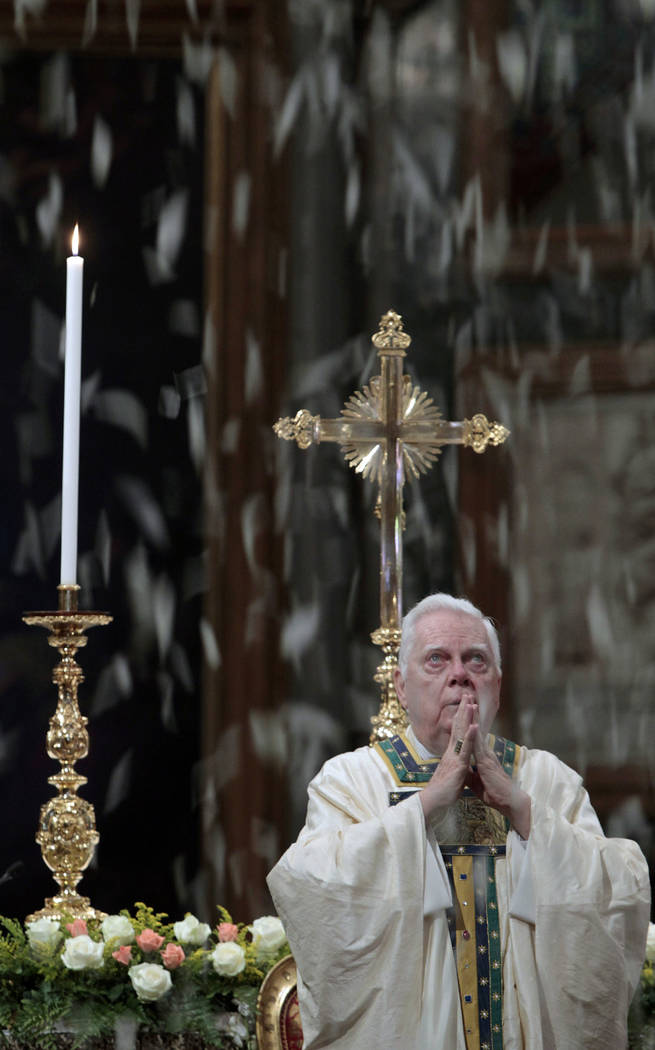 In this Friday, Aug. 5, 2011 file photo, Cardinal Bernard Law celebrates Mass during the ceremony for Our Lady of the Snows, in St. Mary Major's Basilica, in Rome, Italy. An official with the Cath ...