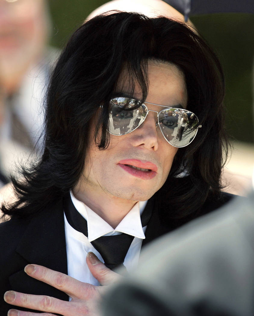 In this June 13, 2005 photo, Michael Jackson gestures as he leaves court during his trial on child molestation charges in Santa Maria, Calif. Wade Robson, who is now 35, testified at Jackson's cri ...