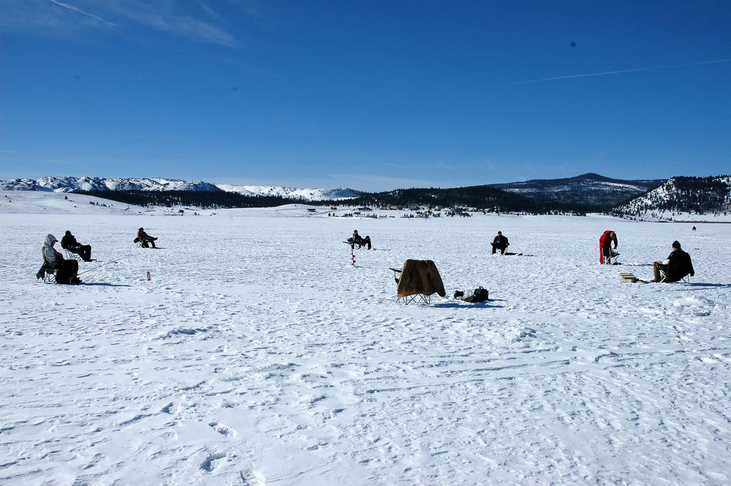 Ice fishing is as much a social event as it is a fishing experience. But be sure to spread out so you dont concentrate the group's weight on a small surface area. (Doug Nielsen/Special to the Revi ...