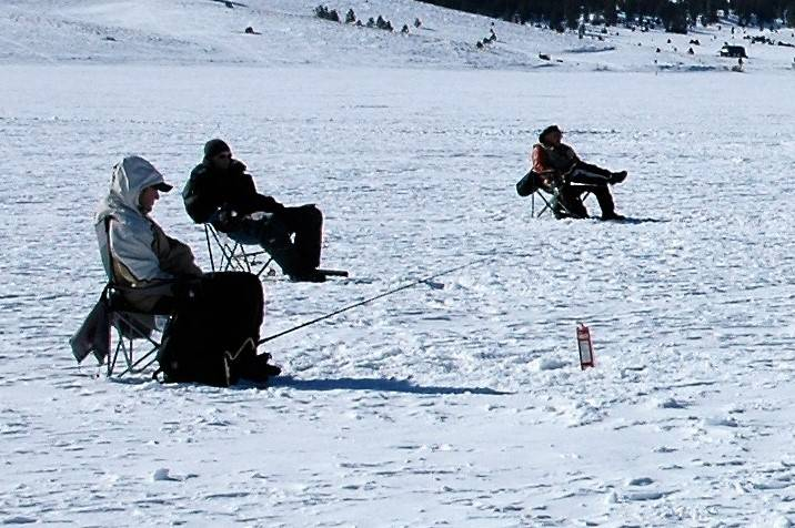 When ice fishing, be sure to pull up a chair and get comfortable. You don't want to stand up for hours or sit on the ice. Be sure to bring a friend or two to share the experience with. (Doug Niels ...
