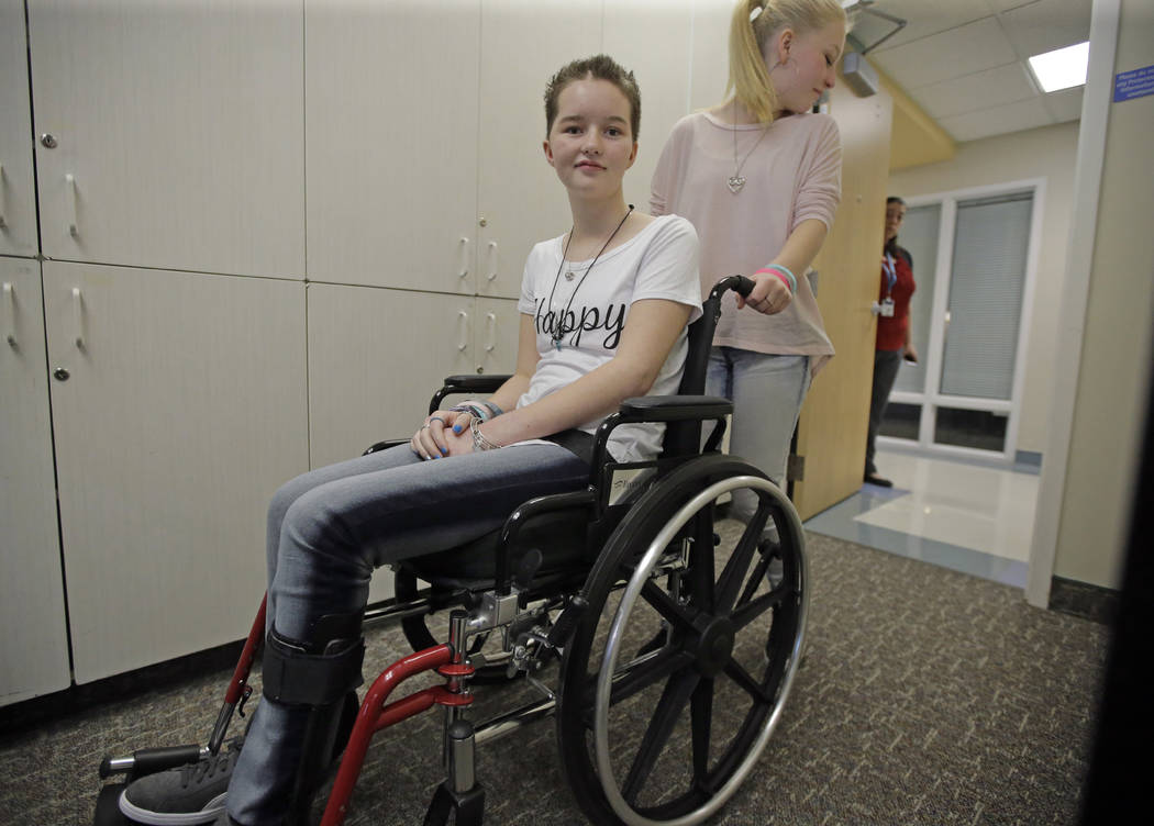 Deserae Turner, a Utah teenage girl who survived being shot in the head by two boys, is wheeled from a news conference after speaking with reporters at Primary Children's Hospital in Salt Lake Cit ...