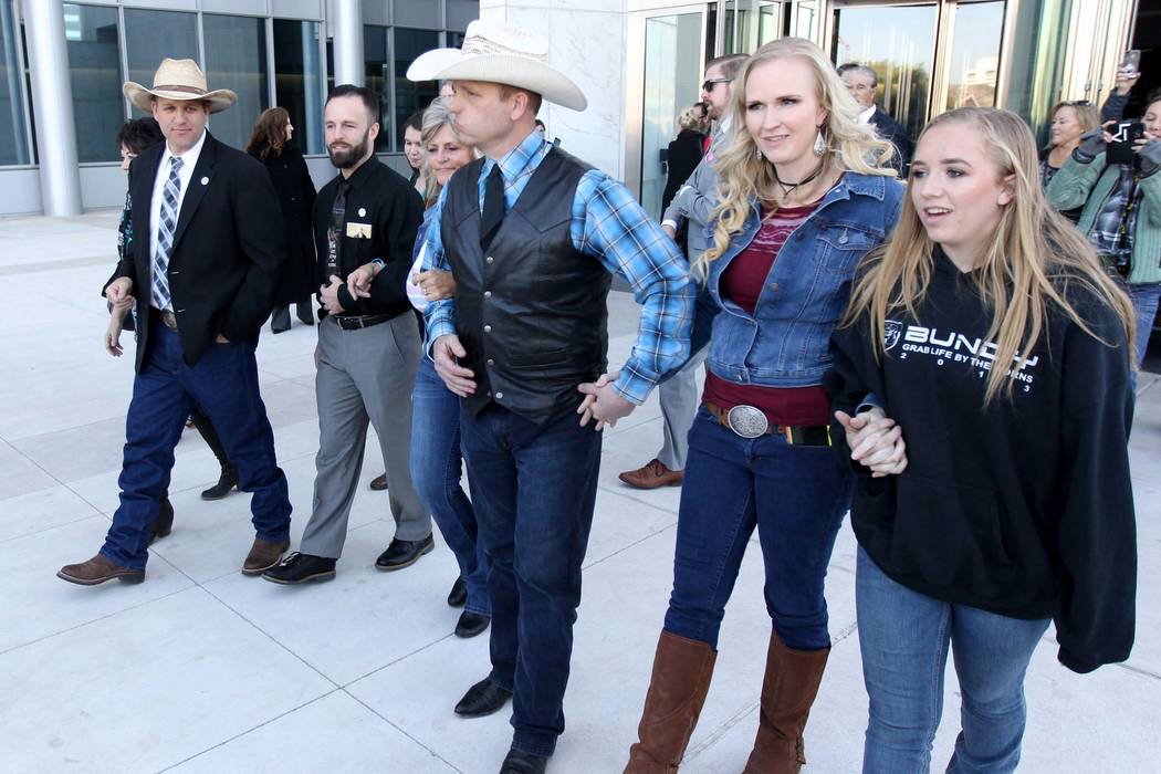Carol Bundy, from left, Ammon Bundy, Ryan Payne, Jeanette Finicum, Ryan Bundy, his wife, Angie, and his daughter, Jamie, walk out of the Lloyd George U.S. Courthouse on Wednesday, Dec. 20, 2017, a ...