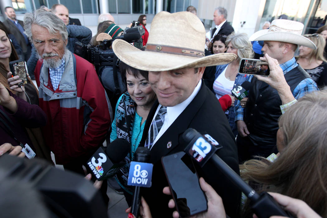 Defendant Ammon Bundy and his mother, Carol Bundy, talk to the news media outside the Lloyd George U.S. Courthouse on Wednesday, Dec. 20, 2017, after a mistrial was declared in the Bunkerville sta ...
