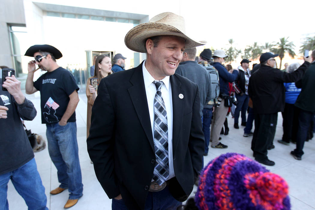 Defendant Ammon Bundy greets supporters outside the Lloyd George U.S. Courthouse on Wednesday, Dec. 20, 2017, after a mistrial was declared in the Bunkerville standoff case involving his father, r ...