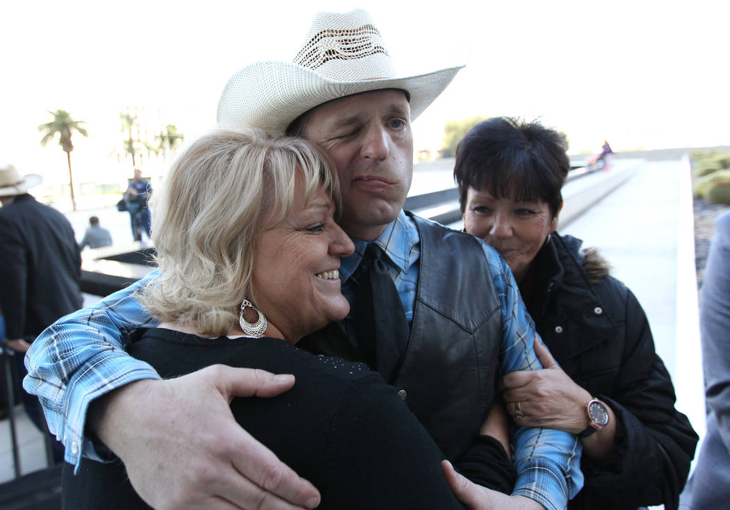 Defendant Ryan Bundy gets hugs from his aunts Lillie Spencer, left, and Margaret Houston outside the Lloyd George U.S. Courthouse on Wednesday, Dec. 20, 2017, after a mistrial was declared in the  ...