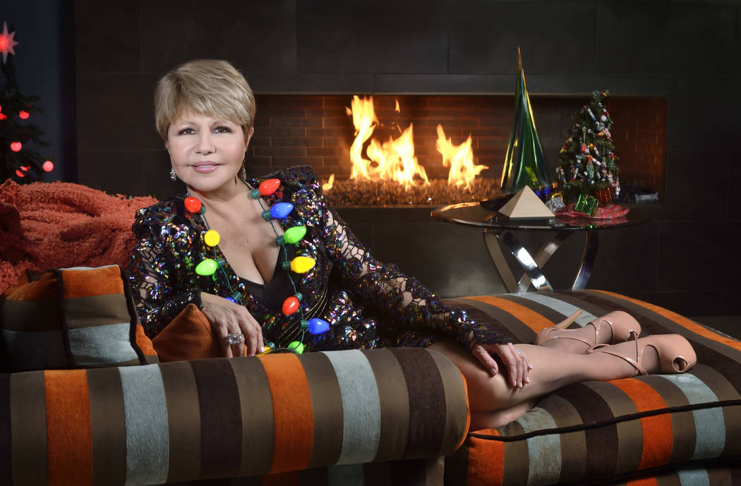 Pia Zadora relaxes by the fireplace at her home in The Ridges in Summerlin. (Bill Hughes Real Estate Millions)