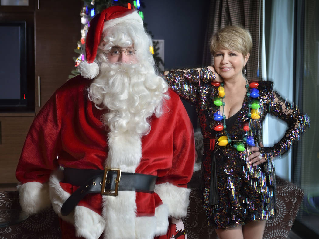 Pia Zadora and her son, Jordan Kaufer, as Santa get ready for Christmas. (Bill Hughes Real Estate Millions)