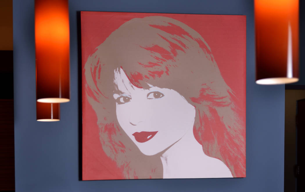 A portrait of Pia Zadora by Andy Warhol is displayed over the living room bar. (Bill Hughes Real Estate Millions)