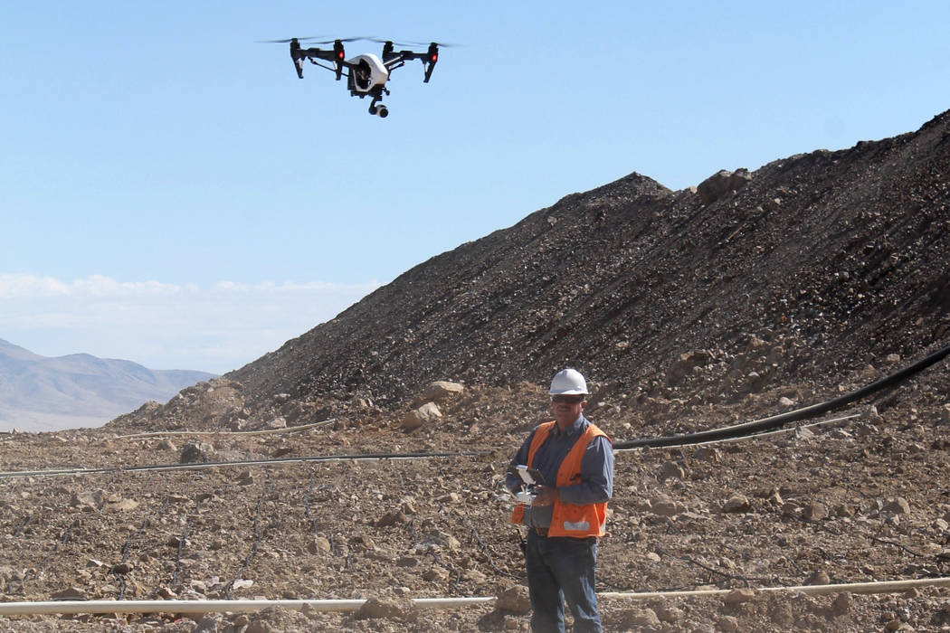 Marigold Mine Chief Surveyor Alan Clayson lands a drone near a leach pad Oct. 5, 2017, at the Marigold Mine in Valmy. SSR Mining Inc. began the process of using unmanned aerial vehicles at the Nev ...