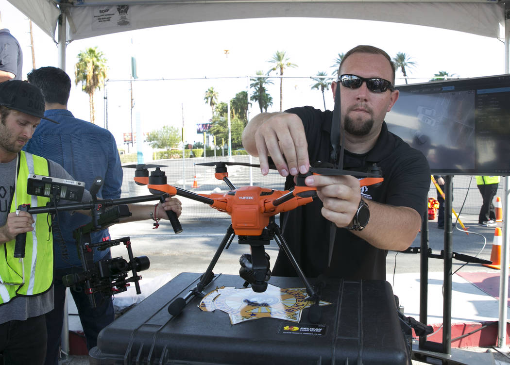 James Spear, unmanned aircraft systems pilot, assembles the Yuneec H520, unmanned aircraft system, after Yuneec and the Nevada Highway patrol demonstrated the latest commercial sUAS during an acci ...