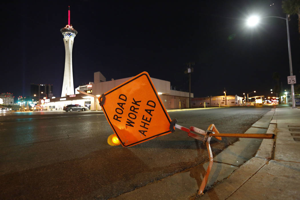 Strong winds take down the road work sign in Las Vegas, Wednesday, Dec. 20, 2017. Strong gusts blew through the Las Vegas Valley on Wednesday evening, causing flight delays at McCarran Internation ...