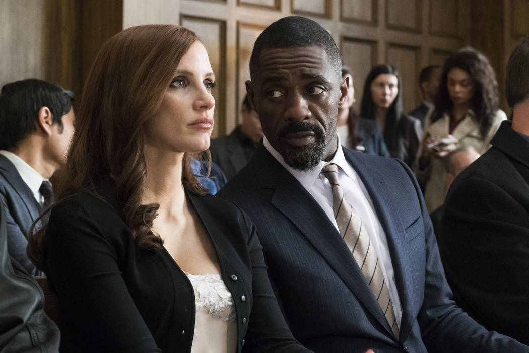 """Jessica Chastain and Idris Elba in """"Molly's Game."""" (Michael Gibson- Motion Picture Artwork © 2017 STX)"""