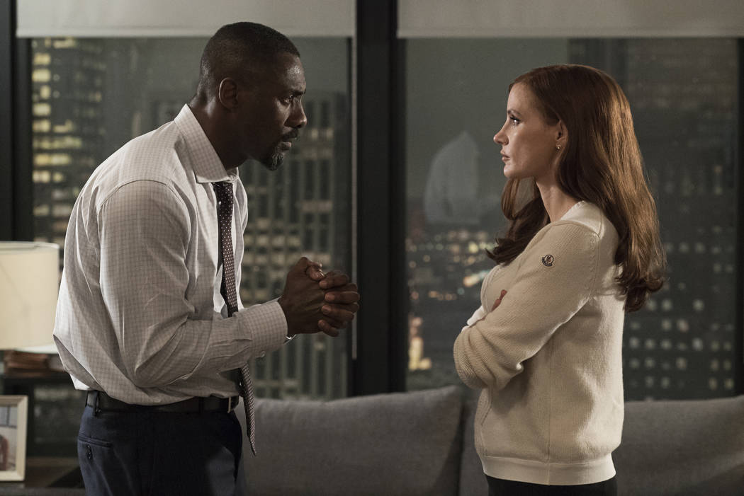 """Idris Elba and Jessica Chastain star in """"Molly's Game."""" (Michael Gibson; Motion Picture Artwork © 2017 STX)"""