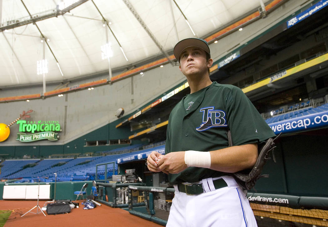 This is a June 7, 2006, file photo showing Tampa Bay Devil Rays' third pick overall in the 2006, Evan Longoria,  taking a look around Tropicana Field for the first time in a Devil Rays uniform, St ...