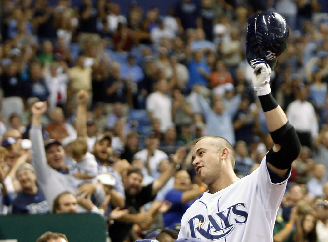 In this Sept. 18, 2008, file photo, Tampa Bay Rays' Evan Longoria makes a curtain call in the seventh inning as fans applaud his third home run of the baseball game against the Minnesota Twins, i ...