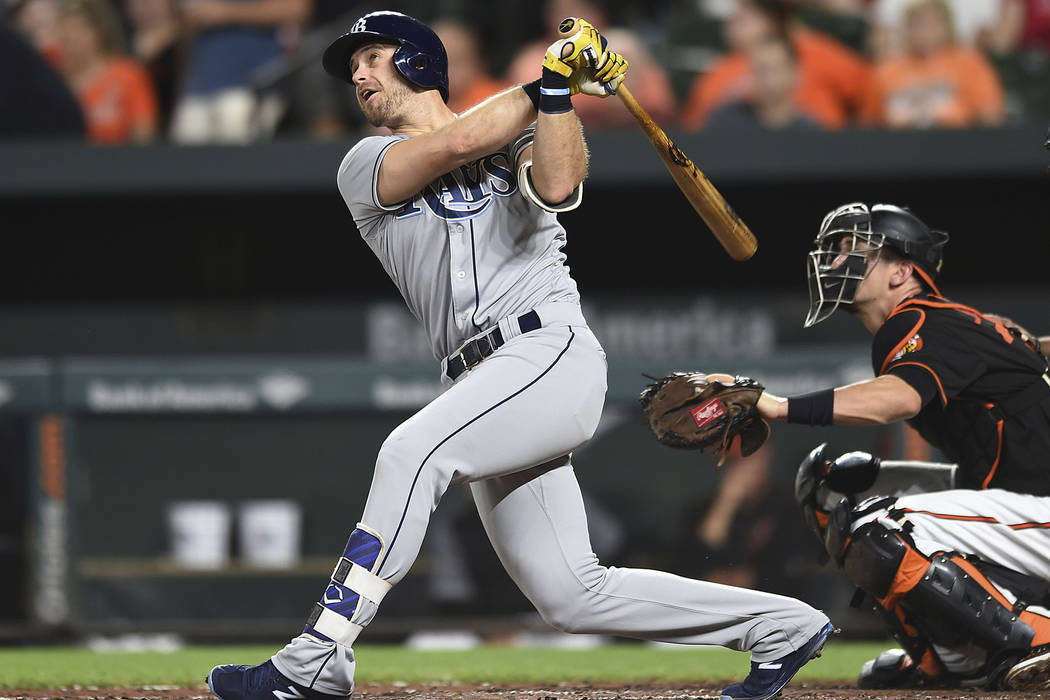 In this Sept. 22, 2017, file photo, Tampa Bay Rays' Evan Longoria follows through on a solo home run against the Baltimore Orioles in the third inning of a baseball game, in Baltimore. The San Fra ...