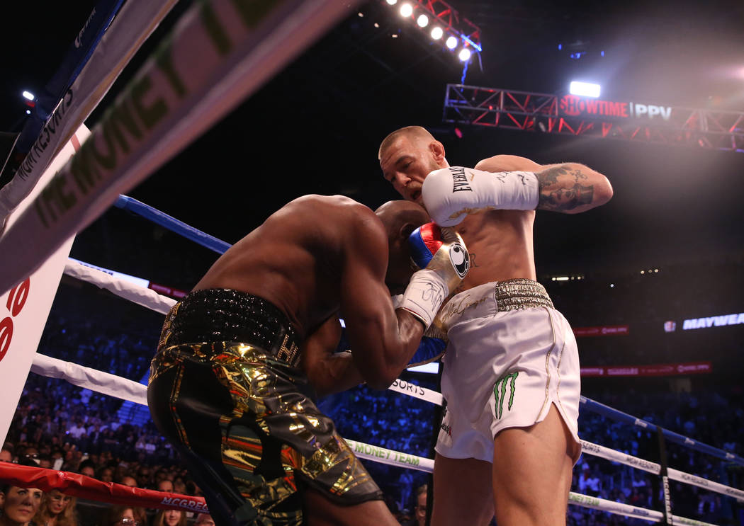 Floyd Mayweather Jr., left, blocks a shot from Conor McGregor during the first round of their fight at T-Mobile Arena, Saturday, Aug. 26, 2017, in Las Vegas. Benjamin Hager Las Vegas Review-Journal