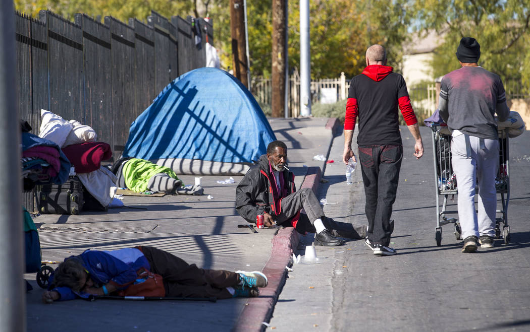 Homeless people gather on Foremaster Lane between Las Vegas Boulevard North and Main Street in Las Vegas, Wednesday, Nov. 22, 2017. Richard Brian Las Vegas Review-Journal @vegasphotograph