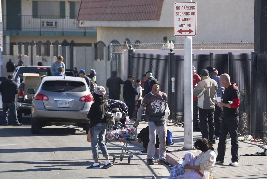 Homeless people gather on Foremaster Lane between Las Vegas Boulevard North and Main Street in Las Vegas, Wednesday, Nov. 22, 2017. Richard Brian Las Vegas Review-Journal @vegasphotograph