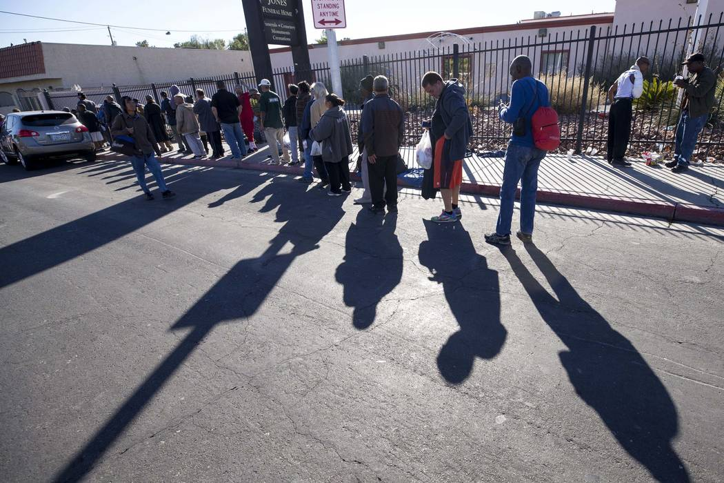 A line homeless people wait for food handouts on Foremaster Lane between Las Vegas Boulevard North and Main Street in Las Vegas, Wednesday, Nov. 22, 2017. Richard Brian Las Vegas Review-Journal @v ...