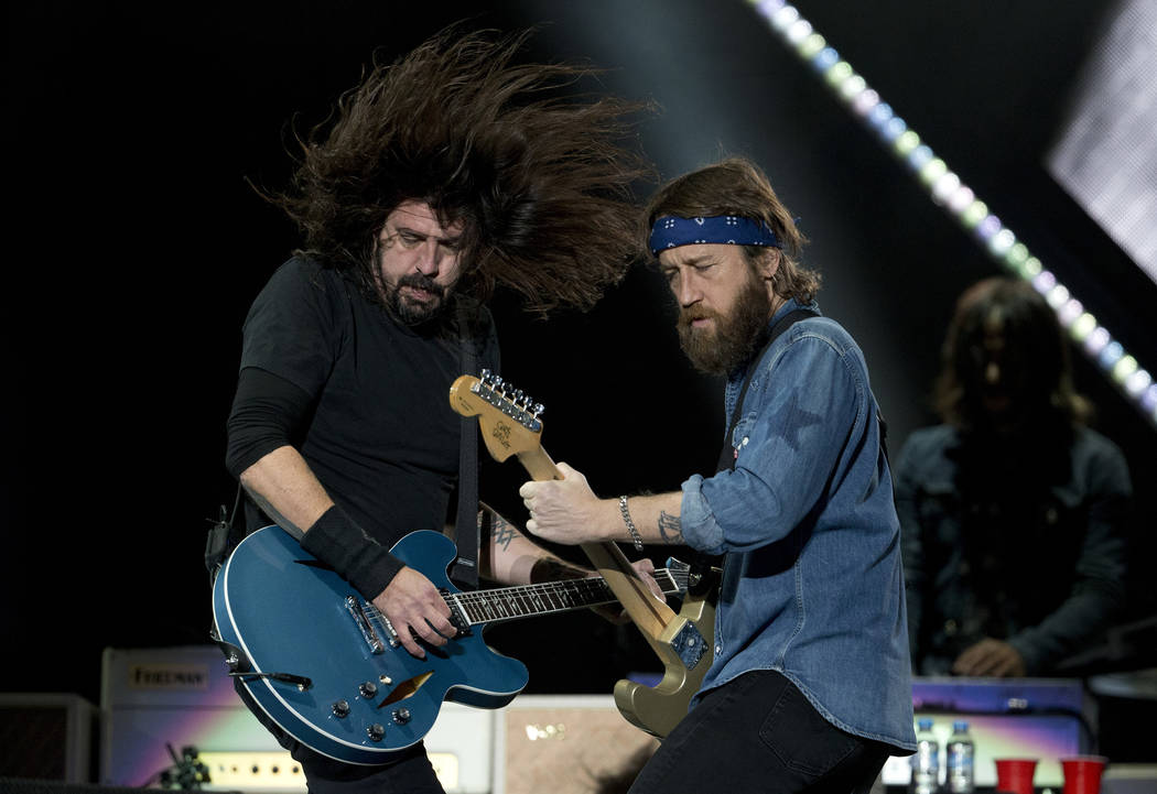 Dave Grohl, left, and Chris Shiflett, from the band Foo Fighters performs during the Corona Capital music festival in Mexico City, Saturday, Nov. 18, 2017. (AP Photo/Eduardo Verdugo)