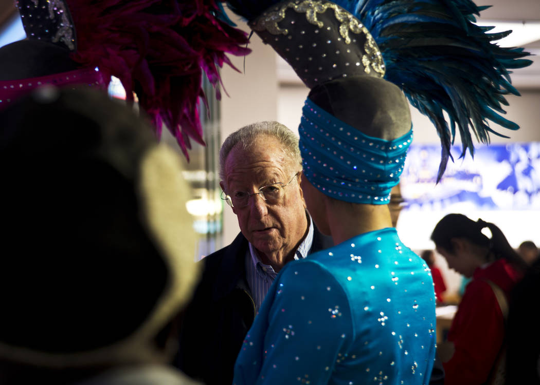 Former Las Vegas Mayor Oscar Goodman arrives during the America's Party news conference announcing details of Las Vegas New Year's Eve celebrations inside the Great Hall of the Fashion Show Mall o ...