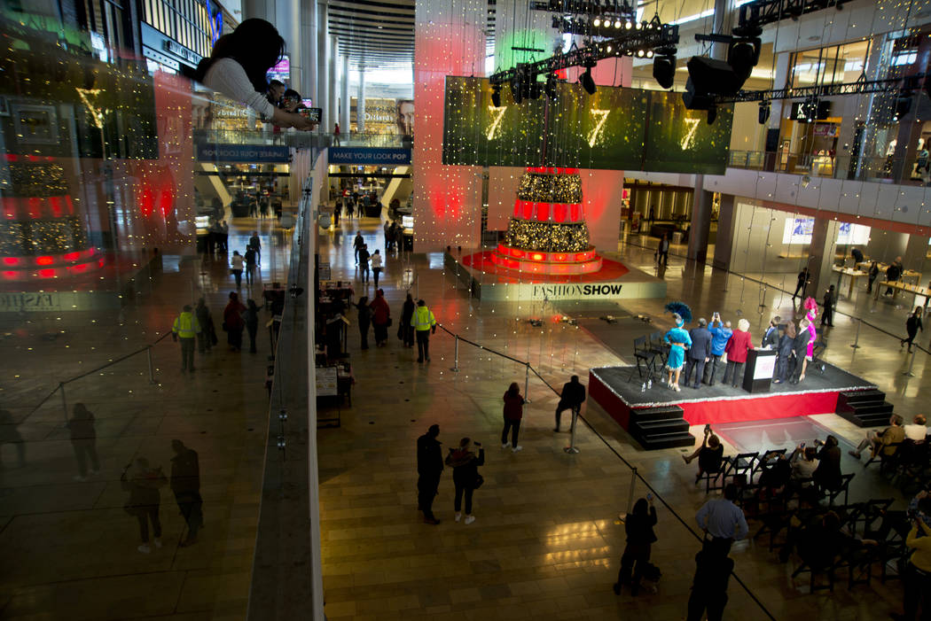 Las Vegas and Clark County officials speak during the America's Party news conference announcing details of Las Vegas New Year's Eve celebrations inside the Great Hall of the Fashion Show Mall on  ...