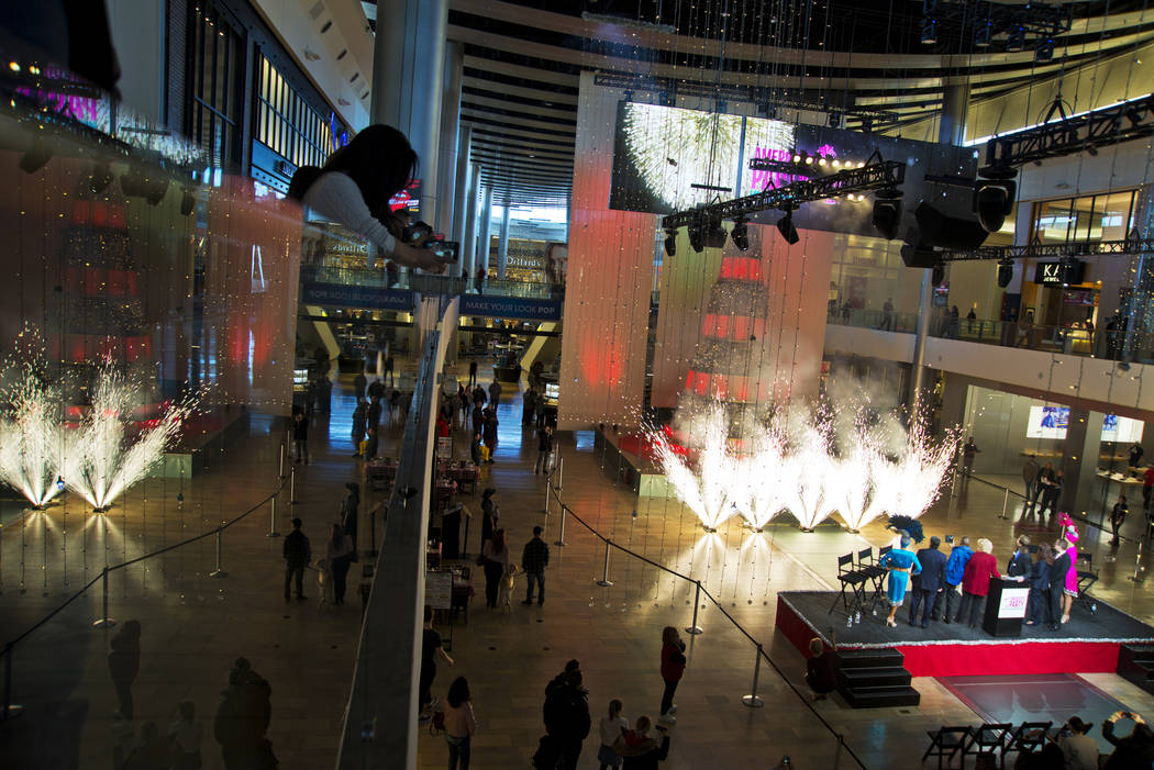 Pyrotechnics go off at the conclusion of the America's Party news conference announcing details of Las Vegas New Year's Eve celebrations inside the Great Hall of the Fashion Show Mall on Thursday, ...